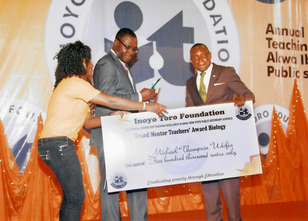 Grand Mentors Teacher Award for Biology being awarded to Michael Thompson Udofia
