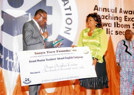 Grand Mentors Teacher Award for English Language being awarded to Irene Ironbar Essien