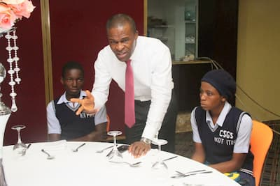 Isaac Idotenyin speaking with students from his adopted school, Community Secondary Grammar School Ikot Itina, Etinan