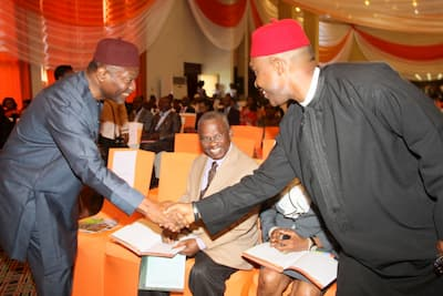 L-R Senator Udo Udoma in a warm handshake with the Guest Speaker Mr Osita Chidoka Seated is General Edet Akpan (rtd) Chairman