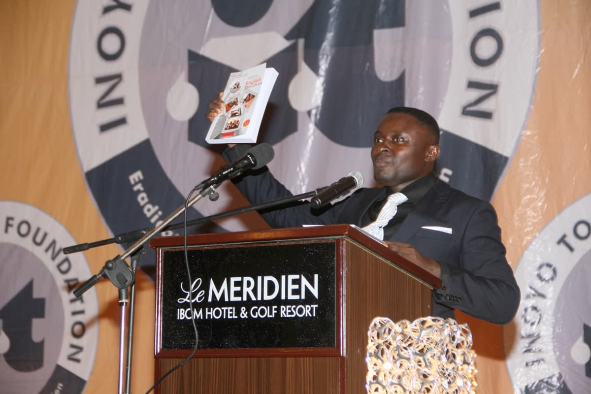 Mr Stephen Abia presenting an English Language Text Book dedicated to the Foundation