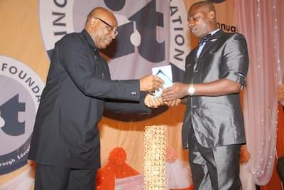 Sponsor of the English Language category Mr Boni Akpan (L) presenting the award to the 3rd prize winner English Language, Stan