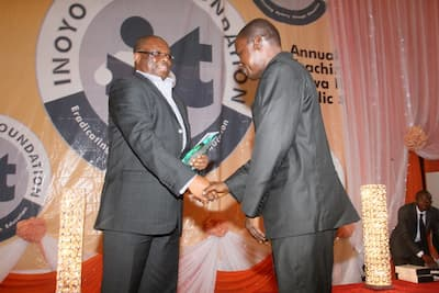 Sponsors of the Biology category, Addax Petroleum represented by Mr Emeka Obi (L) presenting the award to the 3rd prize winner