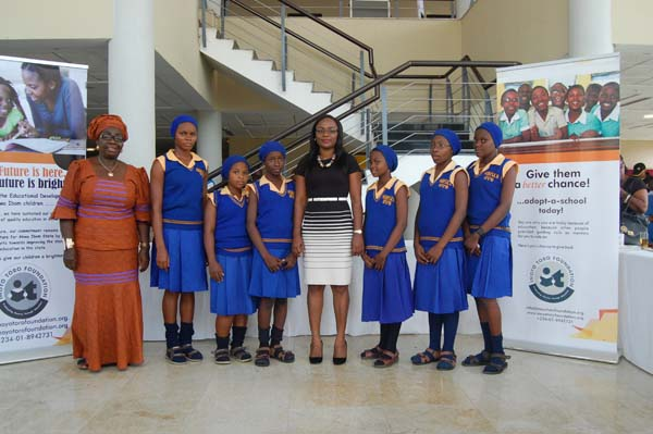 Students of Adiaha Obong Secondary Commercial School, Nwaniba, Uyo LGA and a representative of their mentor Emem Dominic (c)