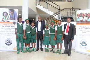 Students of Community Secondary School, Asuna, Etinan and ther mentor Mfon Udom (c)