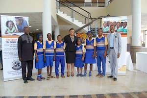 Students of Community Secondary School, Nkek, Ukanafun LGA and their mentor, Rita Umoren (c)
