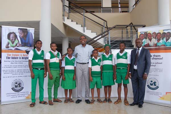 Students of Independence High School, Ukana, Essien Udim LGA and a representative of their mentor Dr Chidi Eneogwe (c)