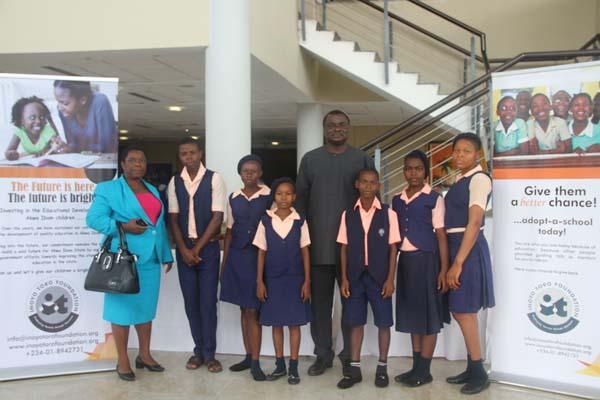 Students of Ndiya Comprehensive School, Ndiya, Ikono LGA and their mentor, Edo Ukpong (c)