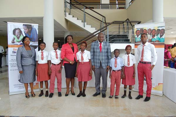 Students of Nsit People Grammer School Afaha Offiong, Nsit Ibom LGA and their mentor Charles Henry (4th right)