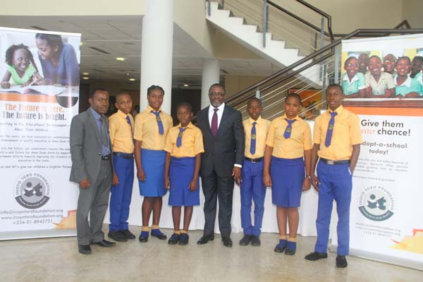 Students of Obong Christian Secondary School, Etim Ekpo LGA and their mentor, Barr Aniekan Ukpanah