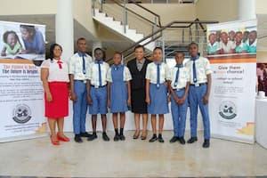 Students of Uyo High School, Uyo and a representative of their mentor Rita Umoren (c)