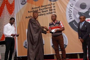 Dr Emmanuel Ekuwem (L) presenting the award to the 3rd prize winner Chemistry, Wilson Bassey Peter