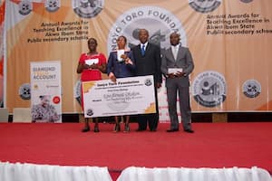 Dr Ini Urua (2nd right) with the winners in the Biology category sponsored by Addax Petroleum
