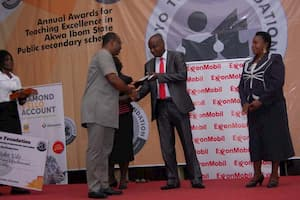 Mr Aniekan Willie (L) presenting the award to the 2nd prize winner Mathematics, Bassey Nyong Bassey