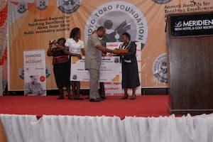 Mr Aniekan Willie presenting the award to the 1st prize winner Mathematics, Mrs Regina John Udo