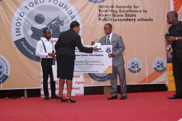 Mrs Rita Umoren, presenting the award to the Grand Mentor Award winner Chemistry, Mr Emmanuel Okon Emmanuel