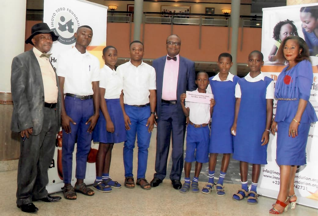 Mr. Antai Effiong with the students and representatives of Community Secondary School, Eyo Abasi Oron