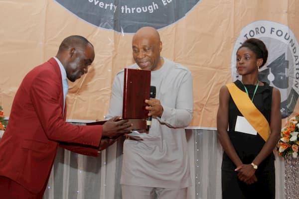 Mr. Boni Akpan presenting Award to Nse Isaaac Ukpong