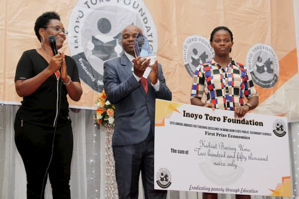 (L-R) Mrs. Emem Nkereuwem, Kubiat Bassey (First Prize in Economics) Umo and Mrs. Kubiat Umo