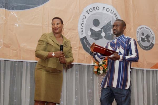 Patricia Akinlotan Of Seven Energy Presenting Another Award