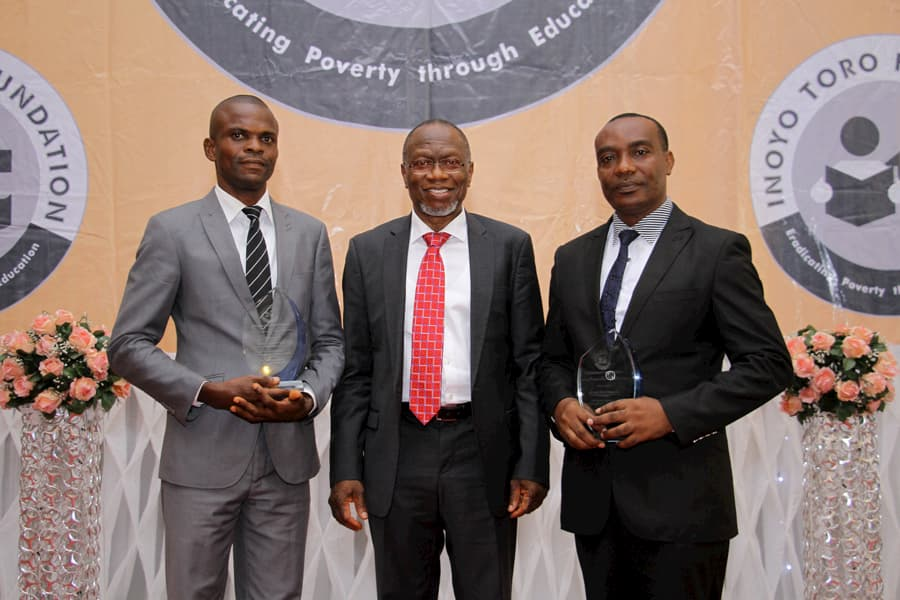 L-R: 2ND POSITION AWARDEE BIOLOGY - MR MBET UDOUDO; DR DOMINIC UKPONG - AWARD PRESENTER; 3RD POSITION BIOLOGY - MR ANIEBIET DICK