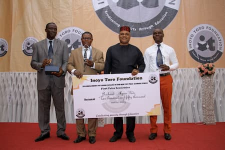 L-R: MR EFFIONG OKON BASSEY - 3RD POSITION ECONOMICS; MR RICHARD AKPAN - 1ST POSITION ECONOMICS; MR ANIEKAN UMANA - AWARD PRESENTER; MR UKE AUGUSYINE - 2ND POSITION
