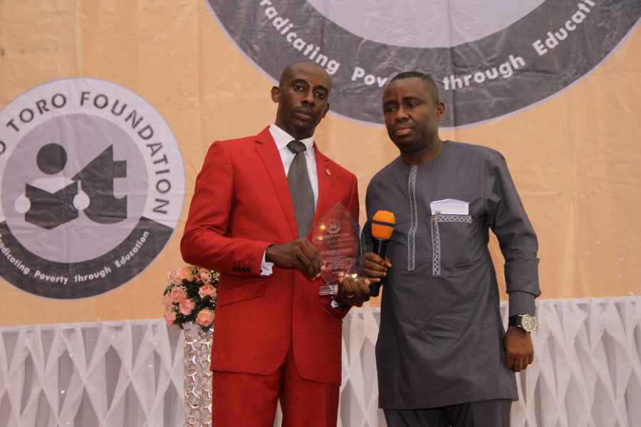L-R: MR MFONOBONG UMO - 3RD POSITION CHEMISTRY; DR GEORGE AKPAN - AWARD PRESENTER