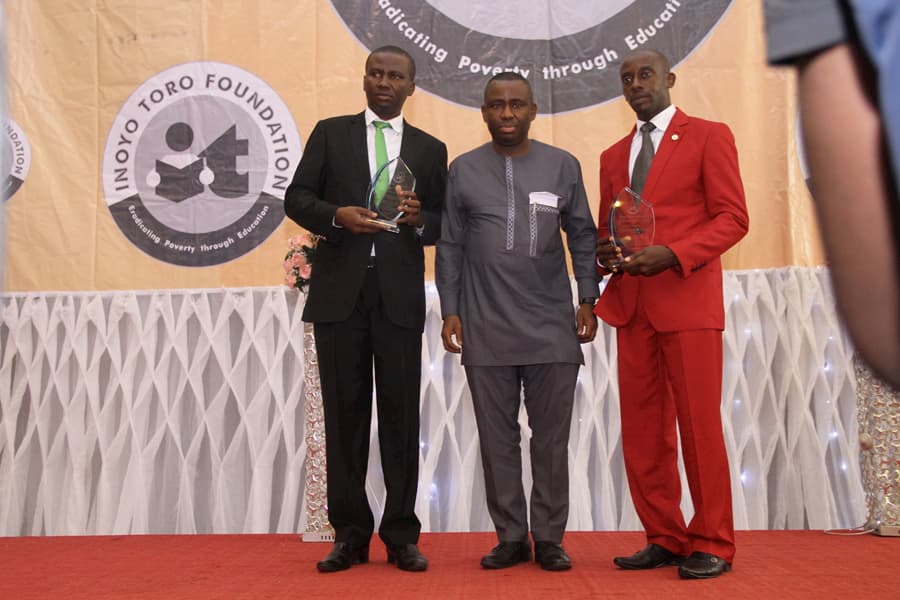 L-R: MR IDONGESIT NKOROK - 2ND POSITION CHEMISTRY; DR GEORGE AKPAN - AWARD PRESENTER; MR MFONOBONG UMO - 3RD POSITION CHEMISTRY
