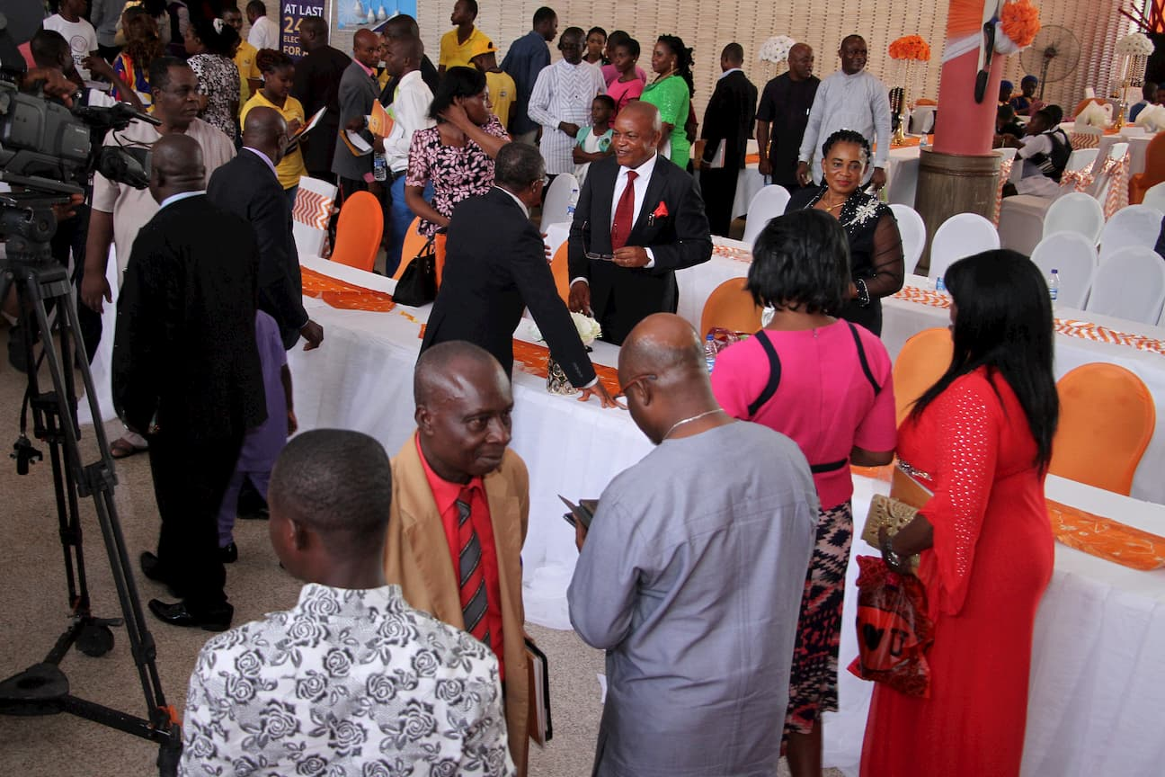 A CROSS VIEW OF GUEST EXCHANGING PLEASANTRIES AFTER THE EVENT