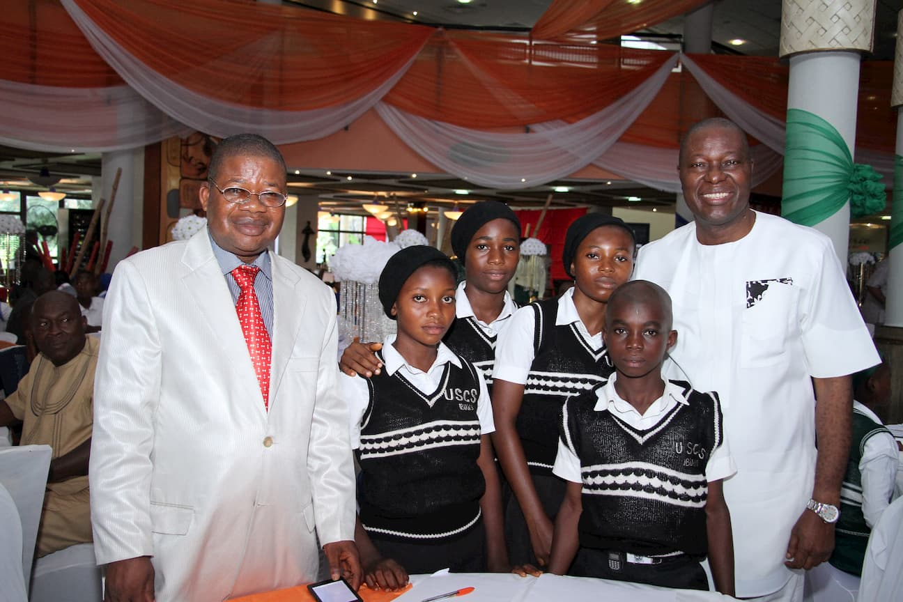 MR EBEBE UKPONG AND THE STUDENTS OF HIS ADOPTED SCHOOL URBAN SECONDARY COMMERCIAL SCHOOL IBIAKU NTOK OKPO