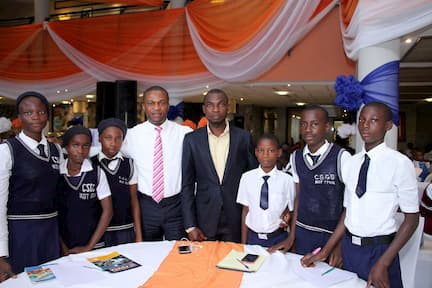 MR IDOTEYIN ISAAC WITH THE STUDENTS OF HIS ADOPTED SCHOOL COMMUNITY SECONDARY GRAMMAR SCHOOL IKOT ITINA