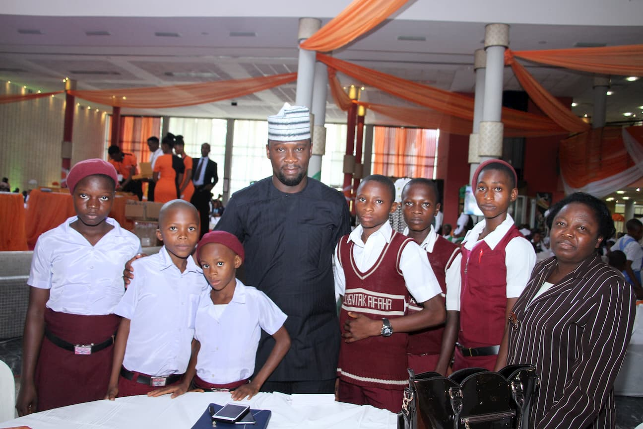 MR NDIANABASI UDOM AND THE STUDENTS OF HIS ADOPTED SCHOOL COMMUNITY COMPREHENSIVE HIGH SCHOOL NTAK AFAHA