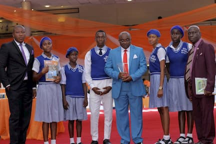 MR NKEKERE UDOM AND THE STUDENTS OF HIS ADOPTED SCHOOL WESTERN ANNANG SECONDARY COMMERCIAL SCHOOL, UKANAFUN