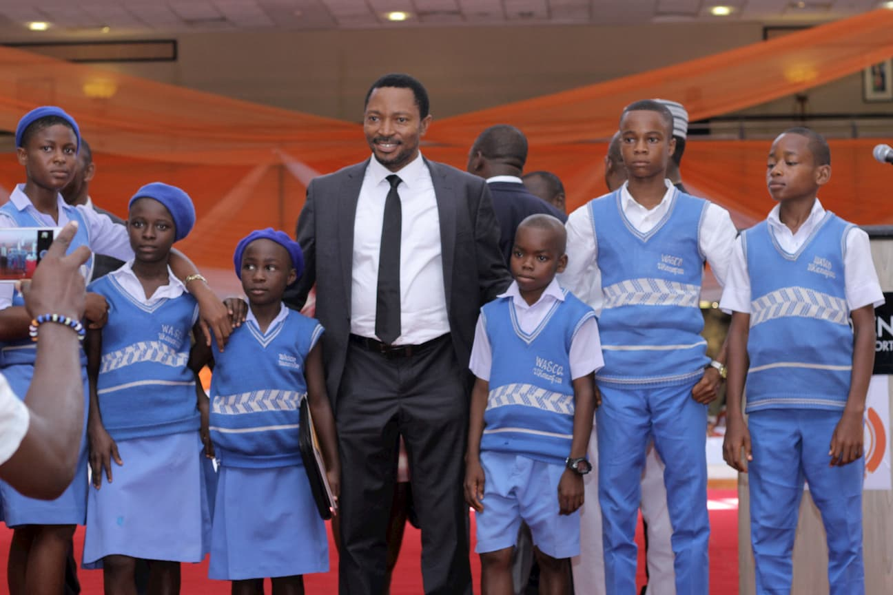 MR NKEKERE UDOM WITH HIS MENTEES FROM HIS ADOPTED SCHOOL WESTERN ANNANG SECONDARY COMMERCIAL SCHOOL UKANAFUN