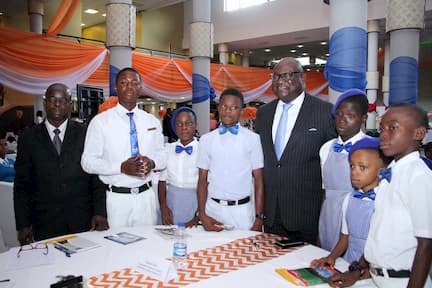 MR UDEME UFOT AND THE STUDENTS OF HIS ADOPTED SCHOOL COMMUNITY SECONDARY GRAMMER SCHOOL, IKOT AKPABIO
