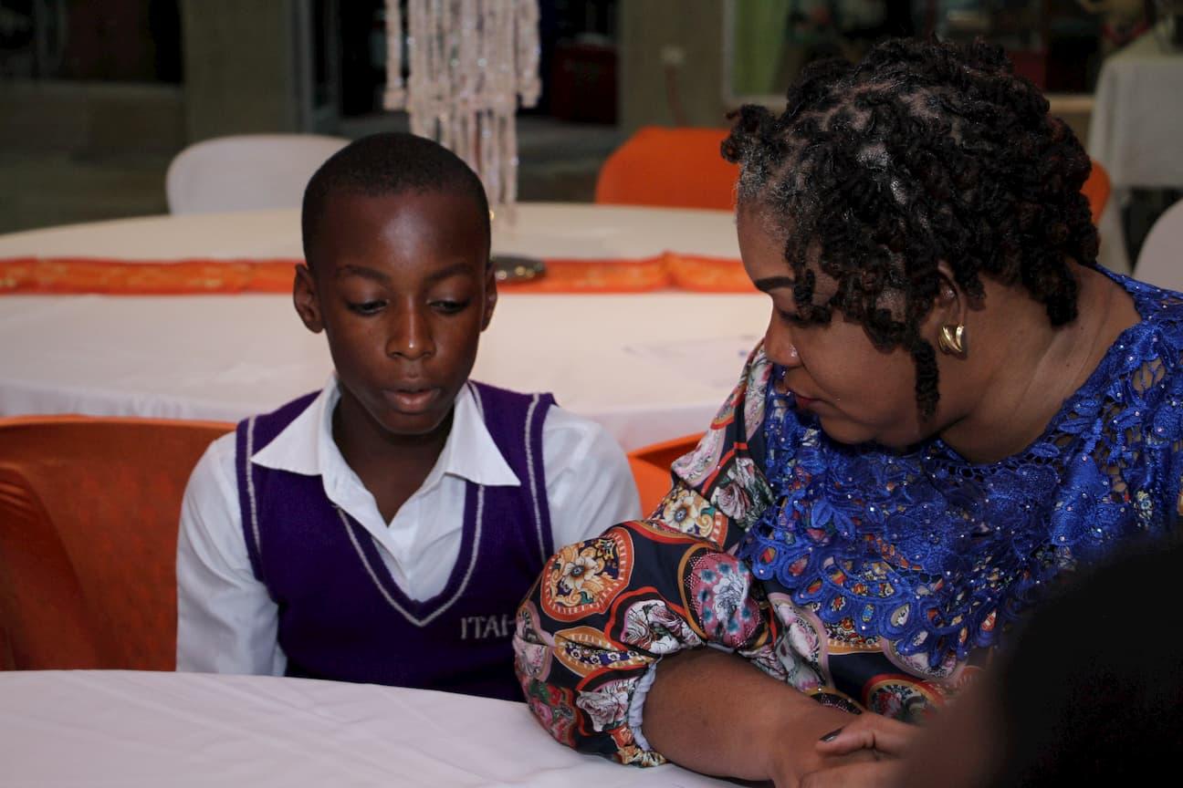 MRS EZINNE KUFRE EKANEM AND A STUDENT FROM HER ADOPTED SCHOOL ITAI COMPREHENSIVE SECONDARY SCHOOL ABIAKPO, IKOT OBIO NTING, IKOT EKPENE