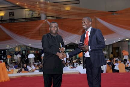 DR GEORGE AKPAN PRESENTING AN AWARD ON BEHALF OF DELTA AFRIK THE SUBJECT SPONSOR TO THE 3RD PLACE CHEMISTRY WINNER FRANCIS WILLIE