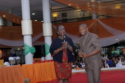 DR. MYMA BELO-OSAGIE PRESENTING AN AWARD TO THE 3RD PLACE WINNER HISTORY ANIETIE MBOM OKON