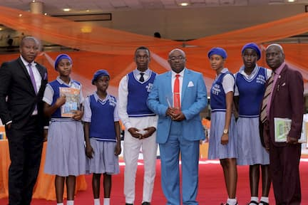THE BEST PRINCIPAL AWARD WINNER 4TH RIGHT AND HIS STUDENTS WHO ARE MENTEES, ALL FROM GOVERNMENT SEC. SCH. AFAHA EKET