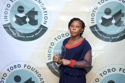 THE ONLY TEACHER WHO QUALIFIED AND GOT AWARDED FOR MATHEMATICS. SHE TOOK 3RD PLACE INIOBONG JACOB ETIM