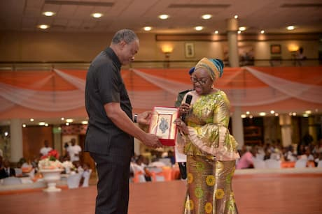 The Head Of The Civil Service of The Federation Mrs. Winifred Oyo-Ita giving a plaque to the Founder Inoyo Toro Foundation