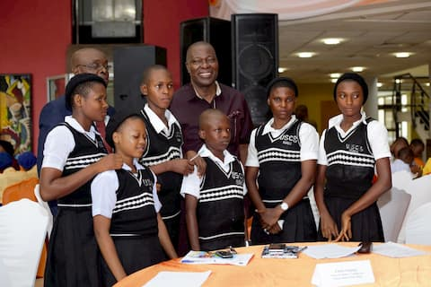 Dr. Ebebe Ukpong and the students of his adopted school