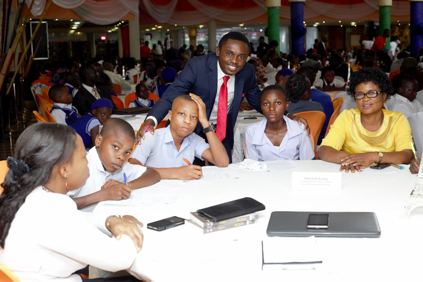 Emmanuel Tishion representing the Mentor Mr. Idorenyin Enang with the students of his adopted school