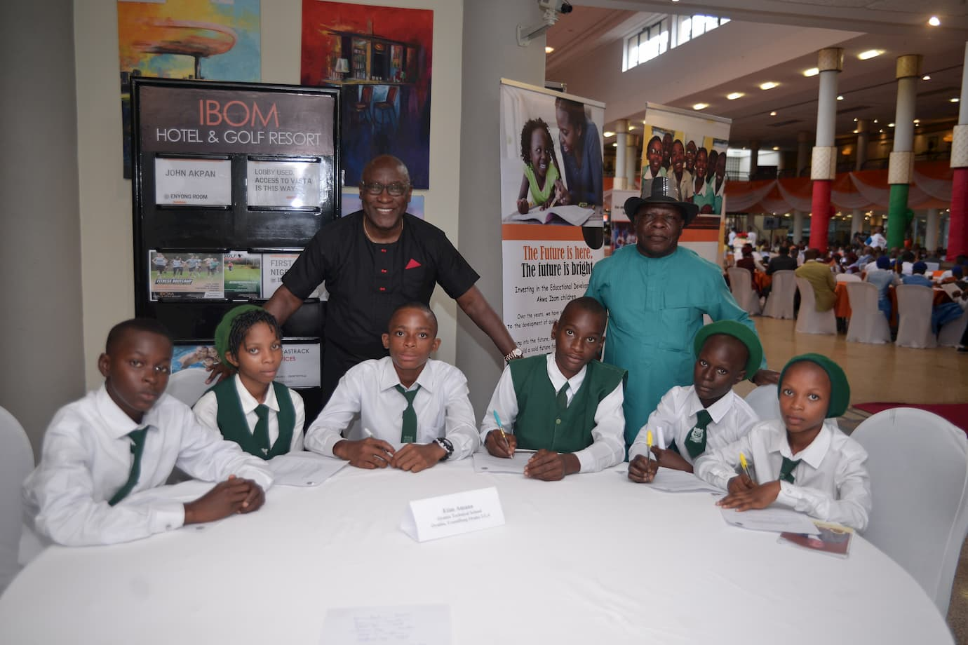 Mr. Etim Amana and the students of his adopted school