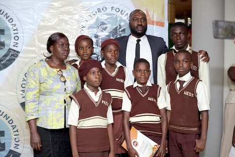 Mr. James Ntukidem and the students of his adopted school West Itam Sec Sch, Ekit Itam II, Itu
