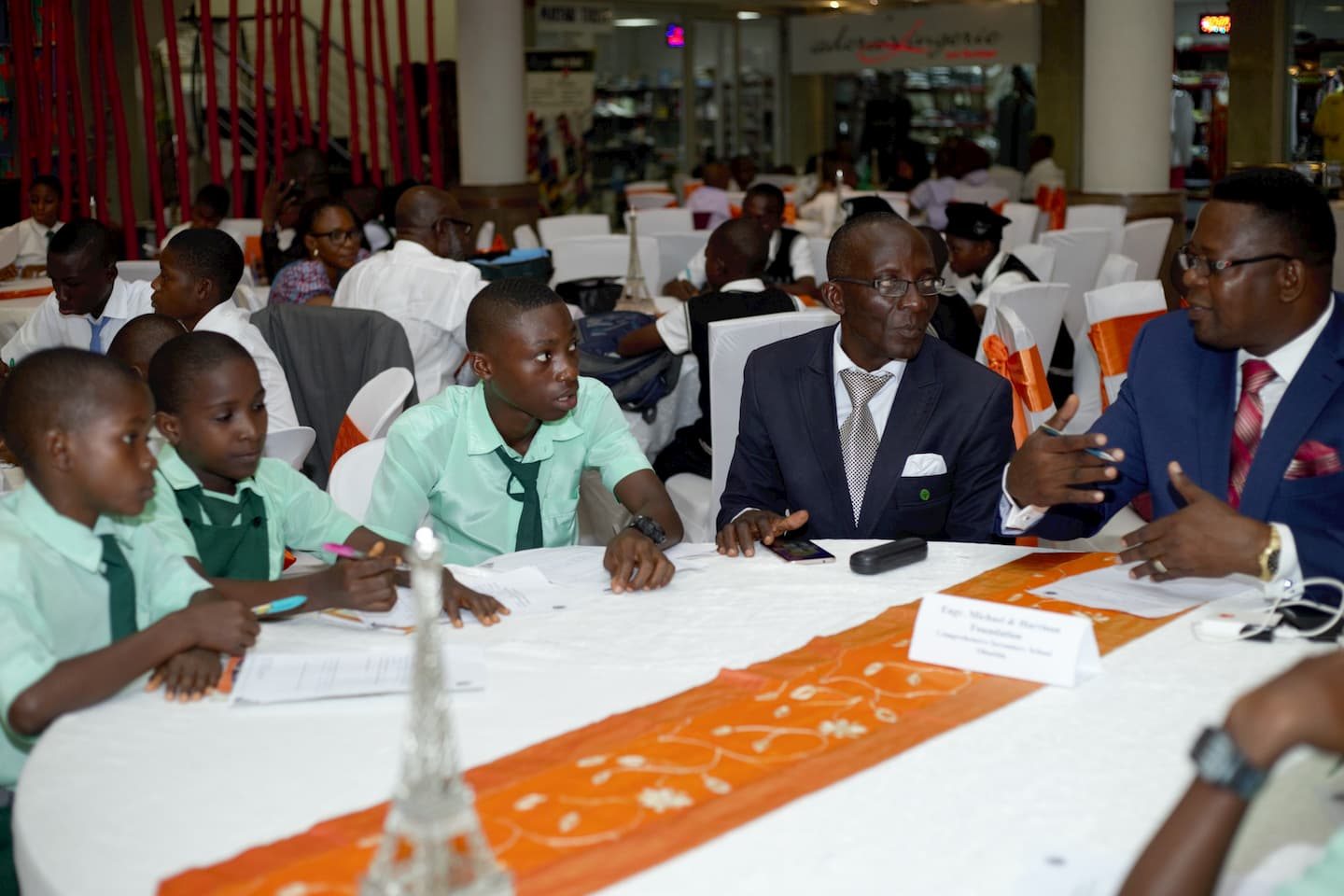Students of Comprehensive Secondary School Oboetim being mentored by a representative of Michael & Harrison Foundation