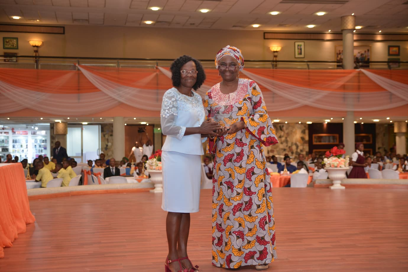 Mrs. Glory Ukpong presenting the Best Principal's Award onbehalf of Bassey Ukpong Udo Foundation to the winner Mrs. Elizabeth U. Michael of Holy Trinity College, Mbiakong Uruan