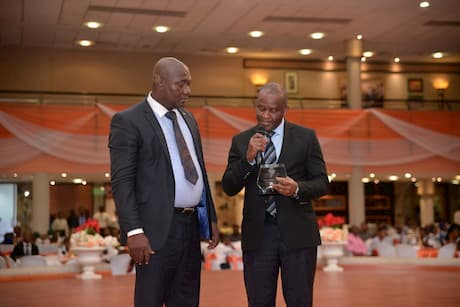 Mr. Bassey Umoh representing Seven Energy Presenting an award to the Grand mentor winner in Mathematics category