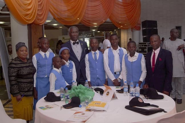 Mr. Aniekan Etibiet and the students of his adopted school