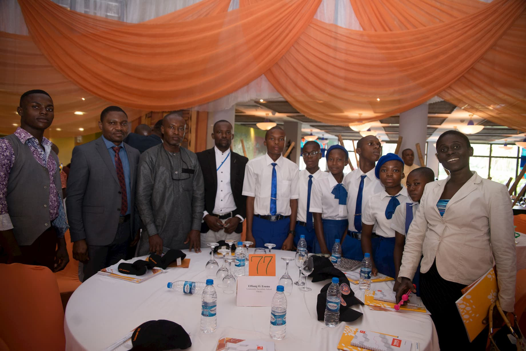 Mr. Esumo Effiong and the students of his adopted school Com. Sec. Sch. Okuko